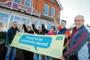 Villagers celebrate buying their community pub
